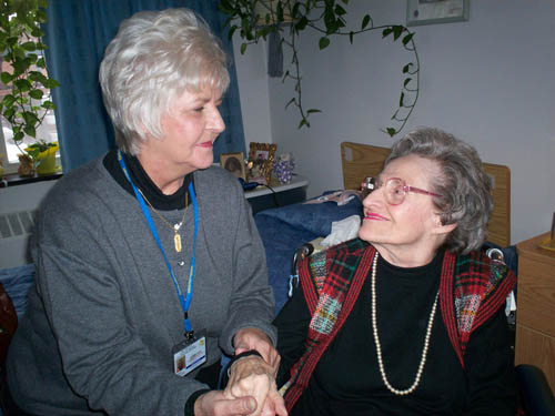 Ombudsman volunteer Judy Lenk visits with a resident.