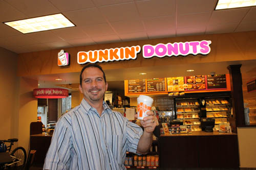 Paul Orsino is the owner and manager of the new Dunkin' Donuts at 2024 Grand Island Blvd. (photo by Larry Austin)