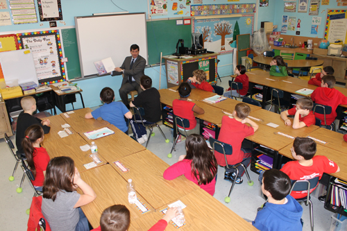 Erie County Executive Mark Poloncarz reads `The Rainbow Fish` to students in Tricia McDonald's fourth-grade class Monday during the Parents As Reading Partners program at Kaegebein Elementary School. (photo by Larry Austin)