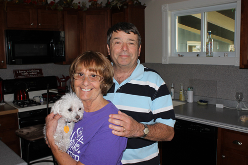 New Islanders Rita and John Thurnherr have joined the Grand Island Relay For Life. Rita holds the couple's dog, Hope.