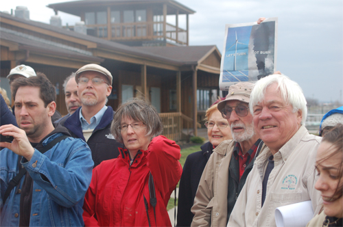 From left, Jeff O'Connell, Diane Evans, David Baker and Roger Cook, members of the Grand Island United Church of Christ/Disciples of Christ congregation, listen to a Sierra Club press conference Tuesday at the Buffalo waterfront that kicks off a campaign promoting renewable energy.