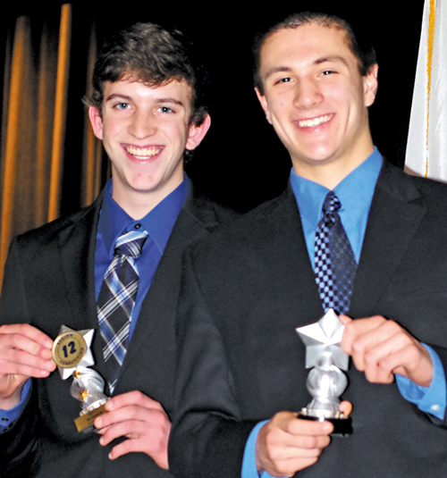 James Rustowicz, left, and Josh Ungaro with the awards they won in the sports and entertainment marketing category at DECA regionals, held Sunday at Lockport High School. (photo by Larry Austin)