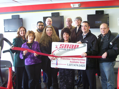 SNAP Fitness on Baseline Road held a ribbon-cutting on Jan. 30 to mark the company's opening on the Island. On hand for the event were, from left, front row: Sandy Preston, SNAP Fitness front desk manager; Maryanne Fechter, SNAP Fitness general manager; Teresa Costello, Grand Island Chamber of Commerce director; Eric Fiebelkorn, Chamber president; and John Bonora, Chamber past president. Back row: Chamber directors Liz Wilbert and Fahim Mojawalla; Mike Woods, Chamber member; Dick Crawford, Town Councilman; and Mary Cooke, Town Supervisor.