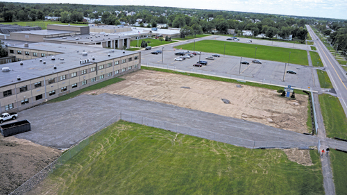 Construction workers clear the ground where the new science, technology, engineering and mathematics wing at Grand Island High School will be located. (photo by K&D Action Photo and Aerial Photography)