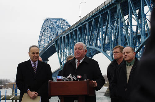 Grand Island Town Supervisor Peter McMahon, right, introduces U.S. Sen. Charles Schumer at a news conference Thursday. Schumer announced legislation that would protect toll discounts for Islanders. (photo by Larry Austin)