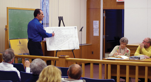 Attorney Sean Hopkins points to a diagram of a concept plan for a development near East River and Whitehaven roads during a meeting of the Planning Board Monday. (photo by Larry Austin)