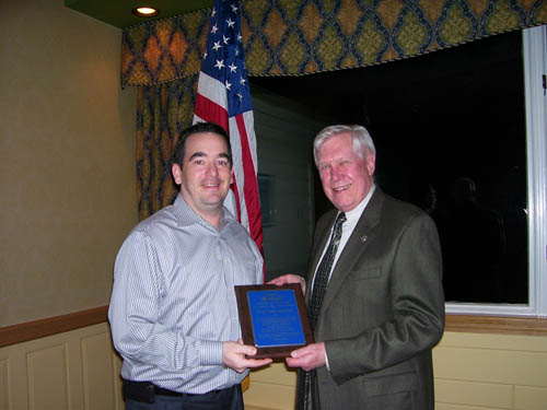 As part of the night's ceremonies, the chamber President Eric Fiebelkorn presented Skip Mazenauer with a plaque to show appreciation for Mazenauer's giving more than 40 years of service and dedication to the Grand Island chamber.  Mazenauer, publisher of the Island Dispatch, is stepping down as a member of the board of directors. He is a past president, vice president, secretary, director and committee chairperson for the chamber.