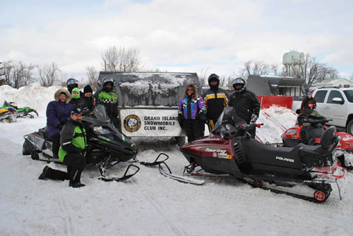 Members of the Grand Island Snowmobile Club pose in front of their logo at Tonawanda's Winterfest at Lincoln Park on Jan. 16 to raise donations for the Ronald McDonald House.
