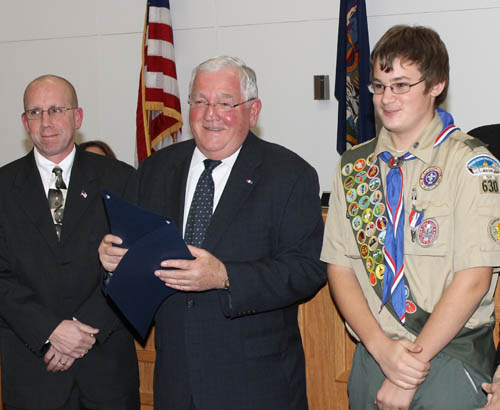 Grand Island Town Supervisor Peter McMahon, center, and the Grand Island Town Board presented a town proclamation to Boy Scout Spencer-Jon Zukic for attaining the rank of Eagle Scout. Also pictured is Councilman Richard Crawford. (photo by Larry Austin)