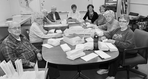 Volunteers from the Golden Age Center were hard at work Thursday helping the town clerk's office send out the 2012 town and county tax bills. (The actual bills aren't their fault.) From left, Don Lewis, Evelyn Lewis, Dorothy Lew, Betty Marinell, Gloria Diringer, Town Clerk Pattie Frentzel, Martha Muller, Christa Bihler and Jean Schlegel. (photo by Larry Austin)