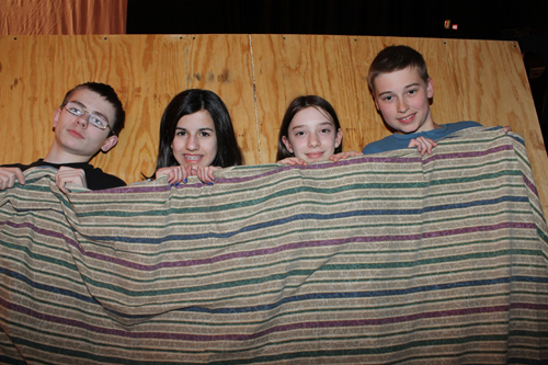 Grandpa Joe (Eric Pease), Grandma Josephina (Sydney Khreis), Grandma Georgina (Kelsey Mahoney) and Grandpa George (Adam Dryfhout) try to catch some sleep.