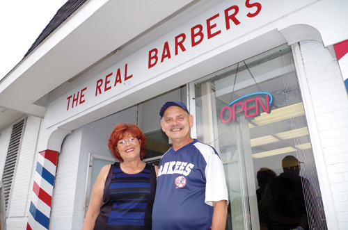 Cindy Montanino and Richard Rosso are pictured outside their barbershop, The Real Barbers II in the Grand Island Plaza. (photo by Larry Austin)