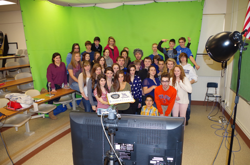 Some of the dozens of members of Grand Island High School's Viking Vision newscast gathered Wednesday to celebrate the 250th show. (photo by Larry Austin)