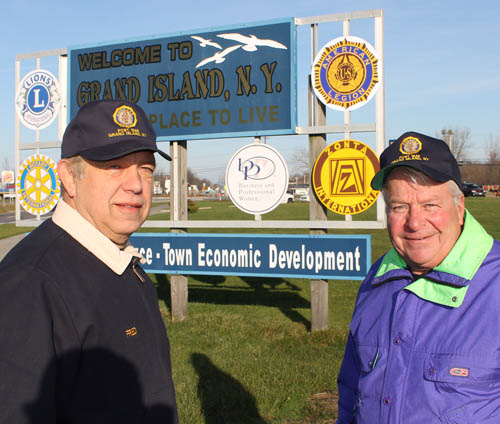 Fred Wornick, commander of American Legion Post No. 1346, left, and Gary Roesch, Grand Island councilman and liaison to the town's Economic Development Advisory Board, checked out the new American Legion logo at the welcome sign on the Island's south end. The logo was added last week.