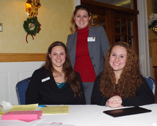 Youth Ambassadors Kelsey Ruszkowski, left, and Ashley Colan raised money for chamber scholarships selling raffle tickets. They're pictured with Nicolette Thompson, chamber director. (photo by Larry Austin)