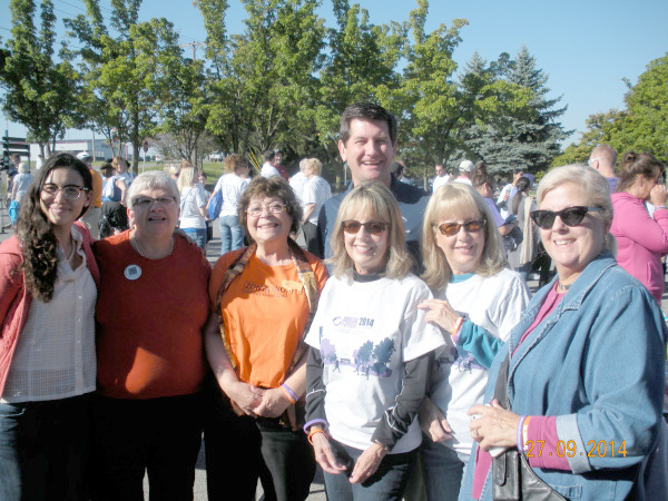 Members of Zonta clubs of Grand Island and Buffalo are pictured with Erie County Executive Mark Poloncarz. Poloncarz joined advocates and supporters of the Domestic Violence Tribute Garden at Saturday's dedication. Located in Isle View park in Tonawanda, the Tribute Garden provides a place for peaceful reflection for individuals and families whose lives have been touched by domestic violence.