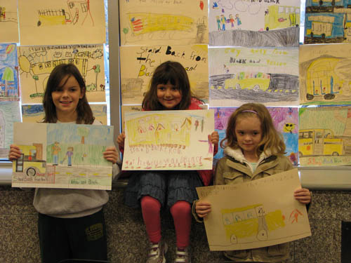 Sidway Elementary and St. Stephen School winners in the School Bus Safety Poster Contest were, from left: Abigail Sonnenberg, fifth grade at St. Stephen; Casey Walowitz and Maia Litwin, both kindergarten students at Sidway.