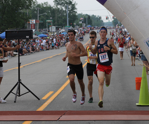 Evan Tsembelis, Nick Masiello and Chris Carter cross the finish line within seconds of each other.