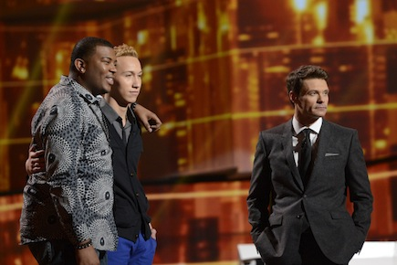 `American Idol`: Curtis Finch Jr. (left), Devin Velez (center) and Ryan Seacrest wait to see who will be eliminated on `American Idol` Thursday on FOX. (photo by Michael Becker/FOX; copyright: FOX)