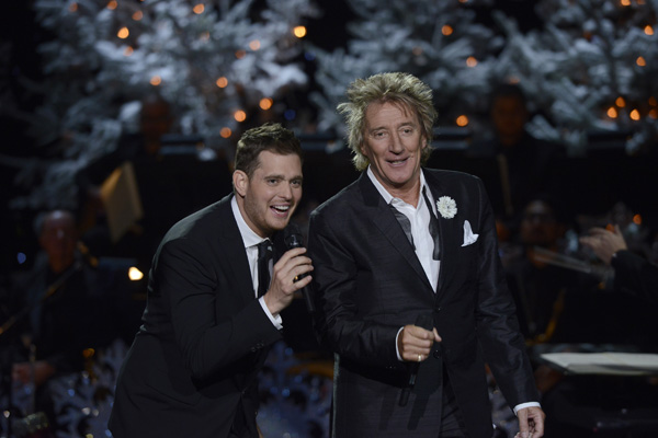 Michael Bublé, left, performs with Rod Stewart as part of `Michael Bublé: Home for the Holidays` on NBC. (NBC photo)