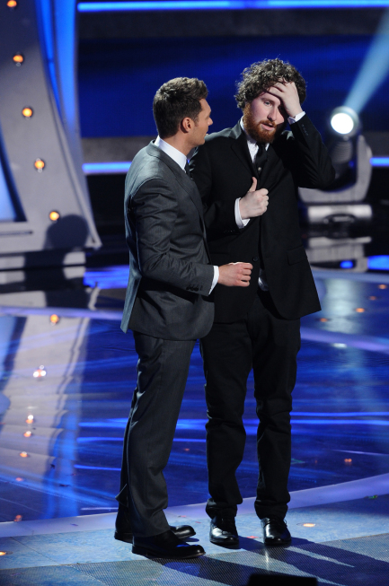 Casey Abrams (right, with Ryan Seacrest) is spared on `American Idol` on FOX. (photo credit: Michael Becker/FOX)