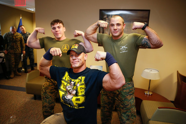 `WWE Tribute to the Troops`: John Cena poses with U.S. troops. (photo by the WWE). The special airs Saturday, Dec. 22, on NBC (9 p.m.); and Wednesday, Dec. 19, on the USA Network (9 p.m.)