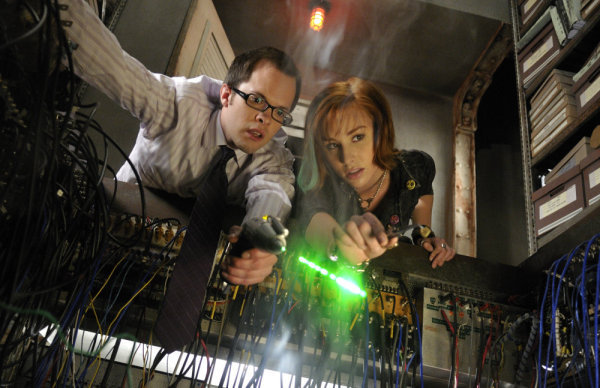 Pictured: Neil Grayston as Douglas Fargo and Allison Scagliotti as Claudia Donovan. (photo by Steve Wilkie/Syfy)