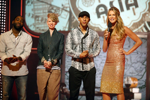 Pictured from NBC's `Fashion Star` `Living Department Store Window` episode are, from left, designers Nzimiro Oputa, Kara Laricks and Edmond Newton, and host Elle Macpherson. (photo by Tyler Golden/NBC)