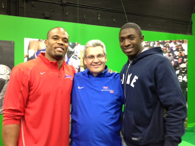 Fred Jackson, left, and T.J. Graham, right, flank Bob Koshinski on `The Fred Jackson Show` on WBBZ-TV.