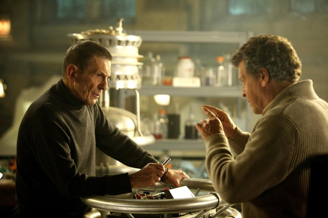 The alternate universe is revealed in part two of the `Fringe` season finale episode `Over There` airing Thursday, May 20, (9 p.m. ET) on Fox. Pictured from left are Leonard Nimoy and John Noble (photo by Fox Broadcasting Co./Liane Hentscher/FOX).