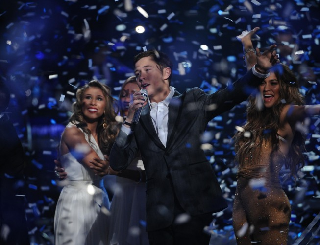 Scotty McCreery learns that he is the next `American Idol` during the season 10 grand finale at the Nokia Theatre on Wednesday, May 25, in Los Angeles. (credit: Michael Becker/FOX)