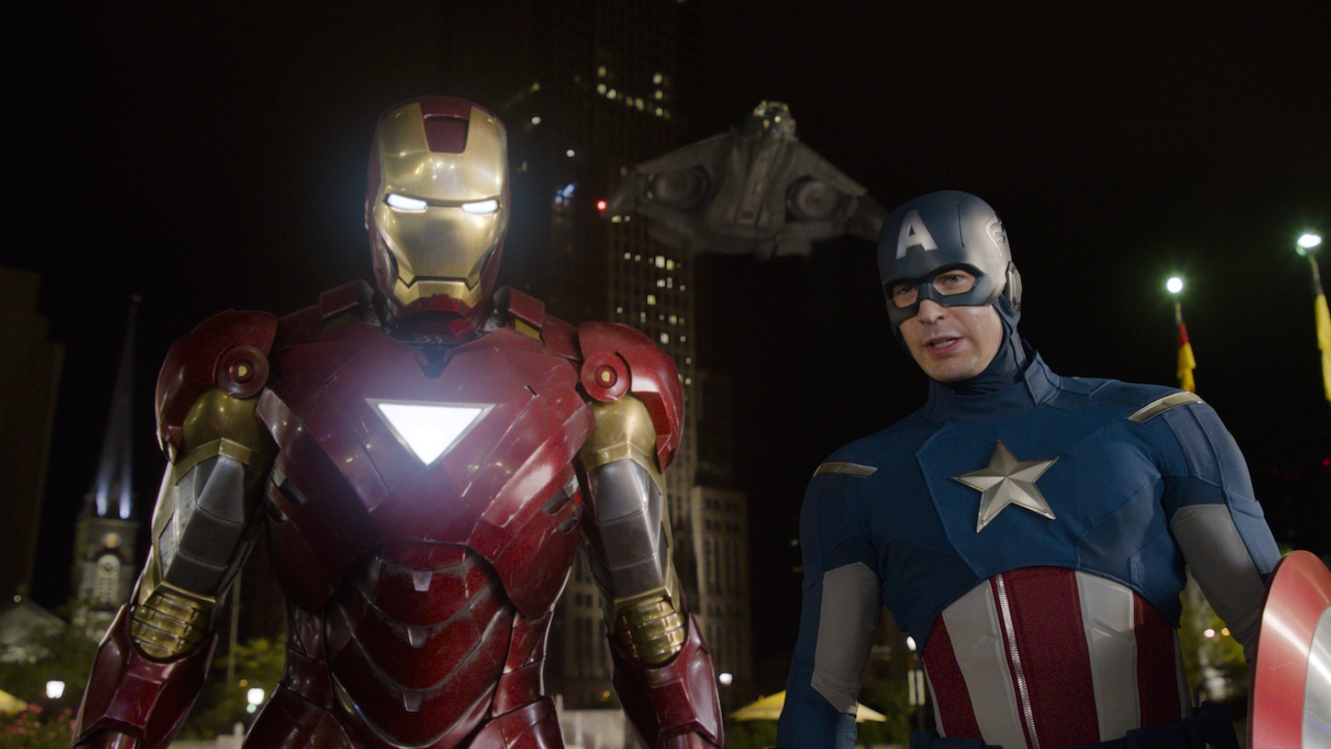 `Marvel's The Avengers`: Iron Man (Robert Downey Jr.), left, and Captain America (Chris Evans) with the Quinjet in background. (photo: Film Frame ©2011 MVLFFLLC. TM and ©2011 Marvel. All Rights Reserved.)