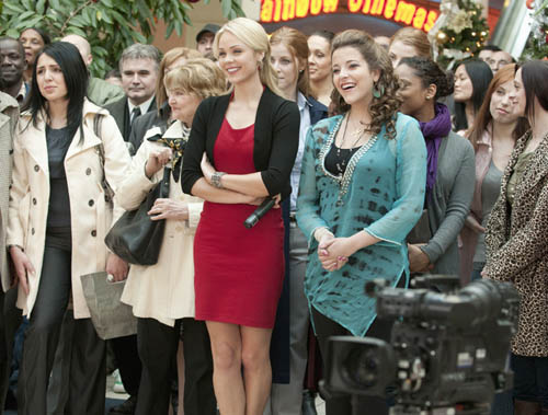 Laura Vandervoort (center) stars in the ABC Family original movie premiere of `Desperately Seeking Santa.` (ABC Family photo by Christos Kalohoridis)