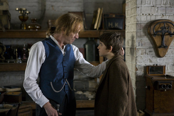 Jimmy Hook (Rhys Ifans) and Peter Pan (Charlie Rowe) like you've never seen them before. (photo by Patrick Redmond/Syfy © NBCUniversal, Inc.)