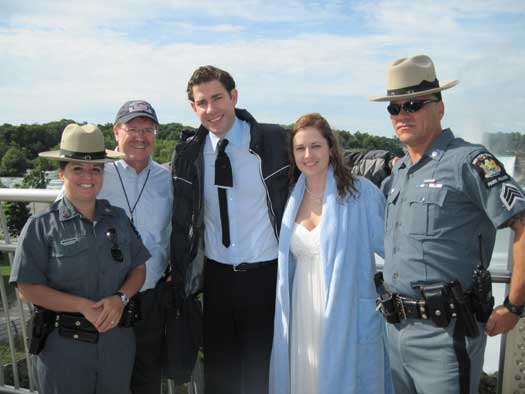 Pam Beesly and Jim Halpert (center) were united in marriage, just outside of Niagara Falls State Park. Here, they are joined by New York State Park Police officer Michele Polanski (far left), State Parks District Director Mark Thomas, and State Parks Sgt. John Marcyan (far right). (photo by Angela Berti)