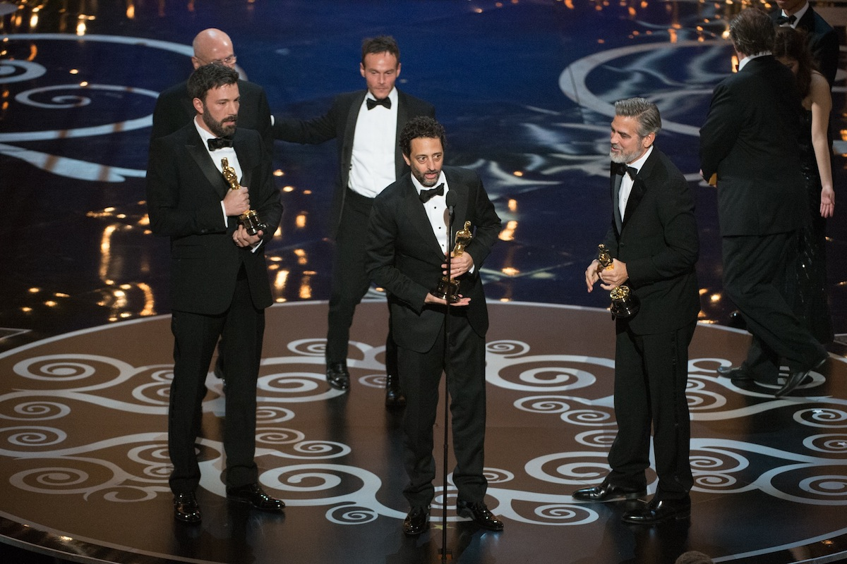 85th Academy Awards telecast: Accepting the Oscar in the category Best motion picture of the year for `Argo` is Ben Affleck, Grant Heslov, and George Clooney during The Oscars. The show aired live on the ABC Television broadcast from the Dolby Theatre in Hollywood on Sunday, Feb. 24. (photo by Matt Brown/©A.M.P.A.S.)