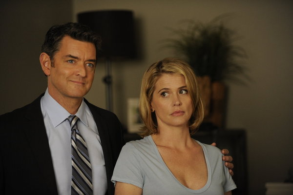 `Psych` star Timothy Omundson is shown with guest star Kristy Swanson, who appears on the show's can't-miss Halloween episode. (Photo by Alan Zenuk/USA Network/©NBCUniversal Inc.)