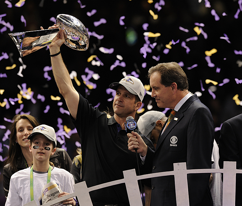 CBS Sports lead play-by-play announcer Jim Nantz presents the Lombardi Trophy to the Baltimore Ravens coach John Harbaugh following the team's win in Super Bowl XLVII Sunday, Feb. 3, on the CBS Television Network. (Photo by Jeffrey R. Staab/CBS ©2013 CBS Broadcasting, Inc. All Rights Reserved.)