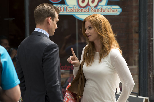 `Suits`: Sarah Rafferty's Donna Paulsen gives Gabriel Macht's Harvey Specter the business. (photo by Christos Kalohoridis/USA Network)