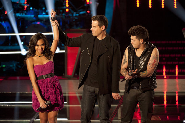 Ashley De La Rosa has her hand lifted in victory by host Carson Daly after defeating Jonathas on `The Voice.` (photo by Lewis Jacobs/NBC)