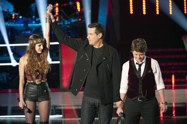 Juliet Simms (left) is declared the winner by host Carson Daly. She defeated Sarah Golden in the `Battle Rounds.` (photo by Lewis Jacobs/NBC)