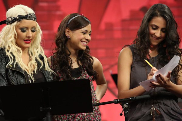 `The Voice`: Coach Christina Aguilera works with singers Joselyn Rivera and Sylvia Yacoub. (photo by Tyler Golden/NBC)