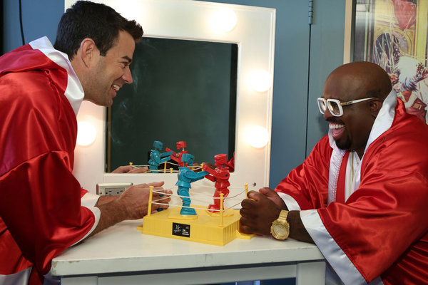`The Voice`: Host Carson Daly and coach CeeLo Green celebrate `Rocktober` and the start of the battle rounds with a Rock'Em, Sock'Em Robots battle of their own. (photo by Tyler Golden/NBC)