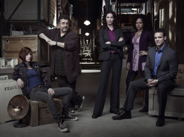 Pictured, from left, is the cast of `Warehouse 13`: Allison Scagliotti as Claudia Donovan, Saul Rubinek as Artie Nelsen, Joanne Kelly as Myka Bering, Genelle Williams as Leena, and Eddie McClintock as Pete Lattimer. (Syfy Channel photo by Justin Stephens)