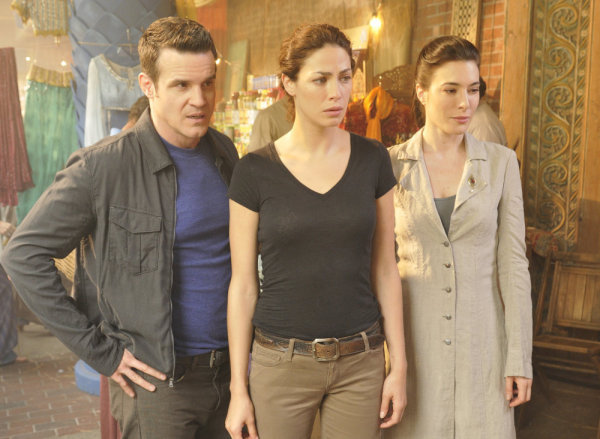 Pictured from `Warehouse 13`: Eddie McClintock as Pete Lattimer, Joanne Kelly as Myka Bering, and Jaime Murray as H.G. Wells (photo by Steve Wilkie/Syfy)