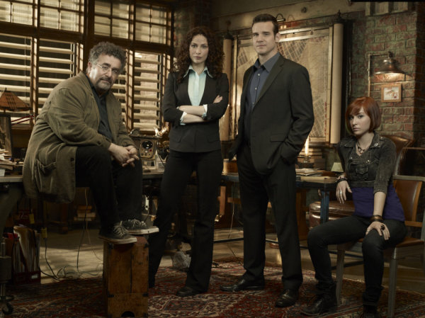 `Warehouse 13` cast. Pictured, from left, are Saul Rubinek as Artie Nielsen, Joanne Kelly as Myka Bering, Eddie McClintock as Pete Lattimer and Allison Scagliotti as Claudia Donovan (photo by Justin Stephens/Syfy)