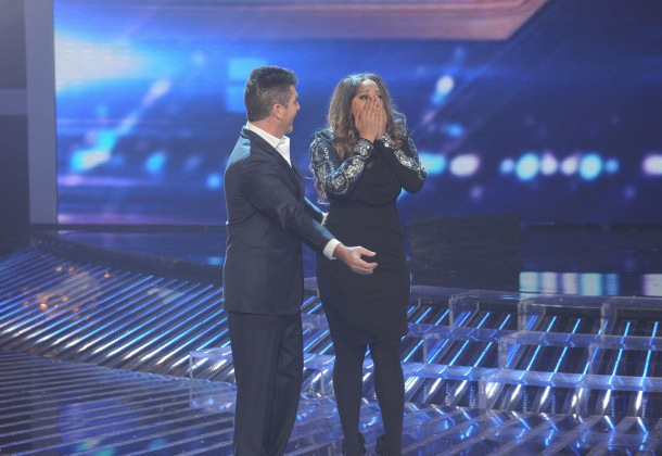 Judge Simon Cowell reacts as Melanie Amaro is announced winner of `The X Factor` on FOX. (photo by Ray Mickshaw/FOX)
