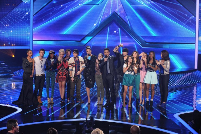 `The X Factor`: The Top 8 were announced on `The X Factor` Thursday, Nov. 22, on FOX. Pictured, from left, are Paige Thomas, Emblem3, Diamond White, Cece Frey, host Khloe Kardashian Odom, Carly Rose Sonenclar, host Mario Lopez, Vino Alan and Fifth Harmony. (photo by Ray Mickshaw/FOX)