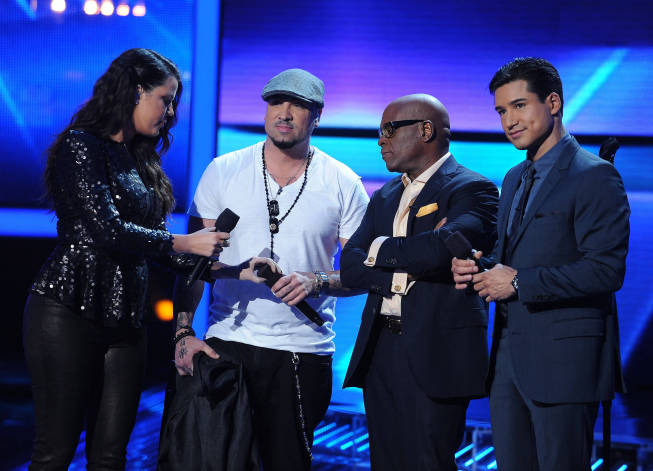`The X Factor`: Vino Alan (second from left) is eliminated from the competition on Thursday, Nov. 29, on FOX. Also pictured, from left: Khloé Kardashian Odom, L.A. Reid and Mario Lopez. (photo by Ray Mickshaw/FOX)