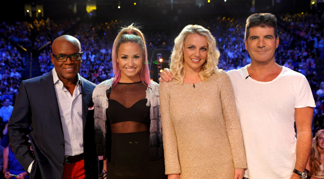 Pictured from `The X Factor`: L.A. Reid, Demi Lovato, Britney Spears and Simon Cowell on the set of the hit FOX series. (photo by Ray Mickshaw/FOX)